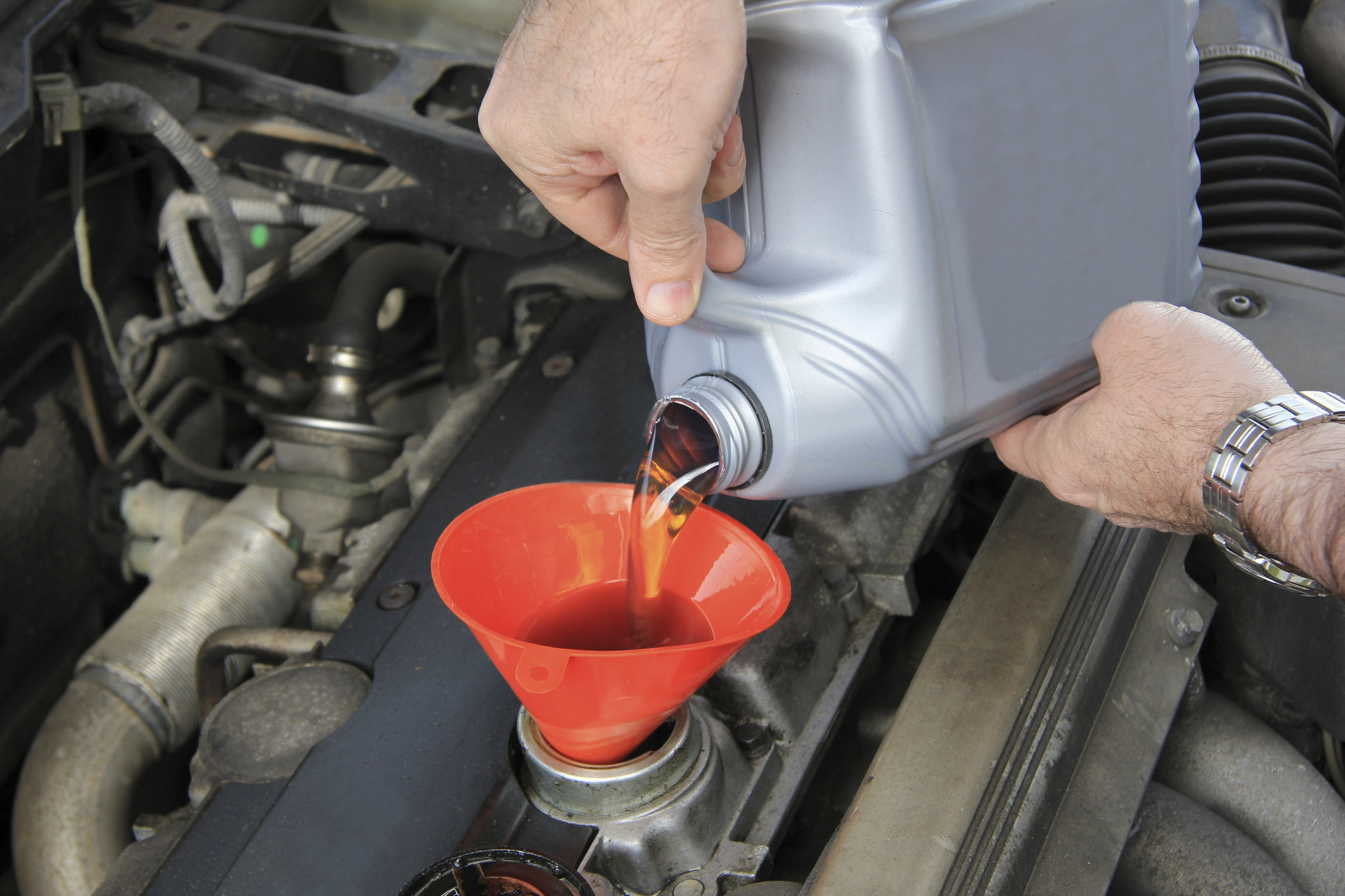 Refilling engine oil of an older car